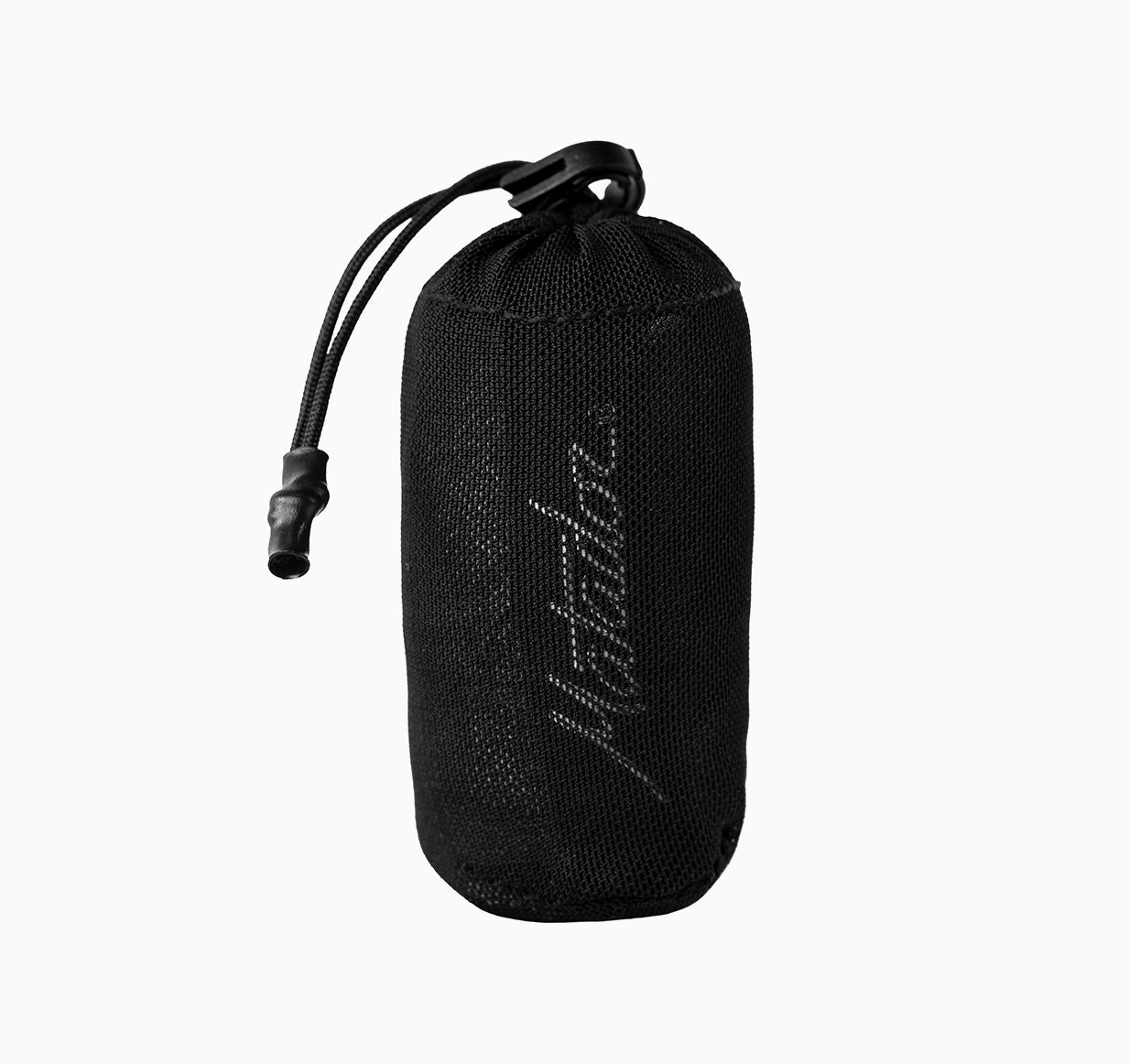 Packed down trek towel pouch on white background