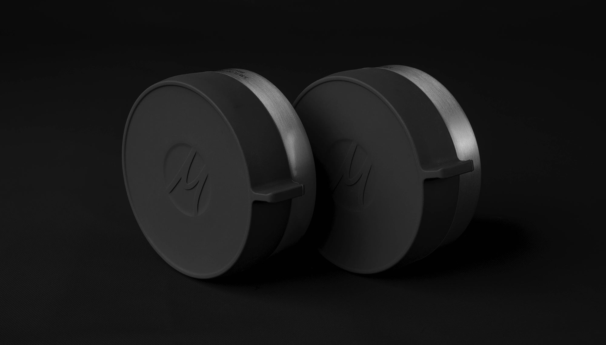 Two canisters on black background