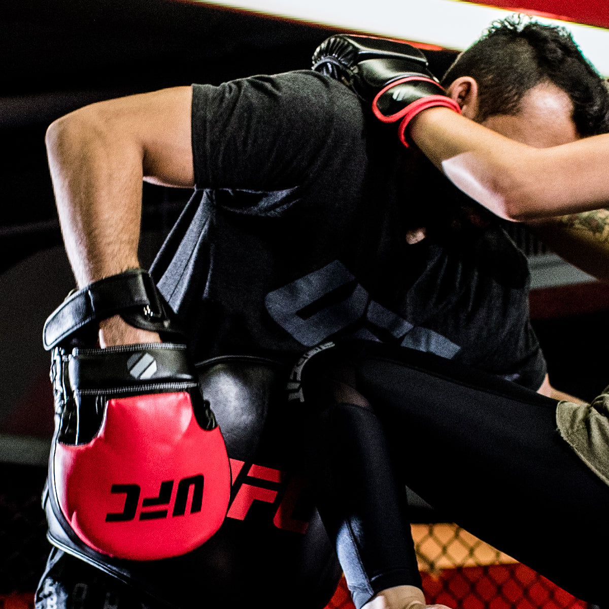 UFC Long Curved Focus Mitt being used by coach in training