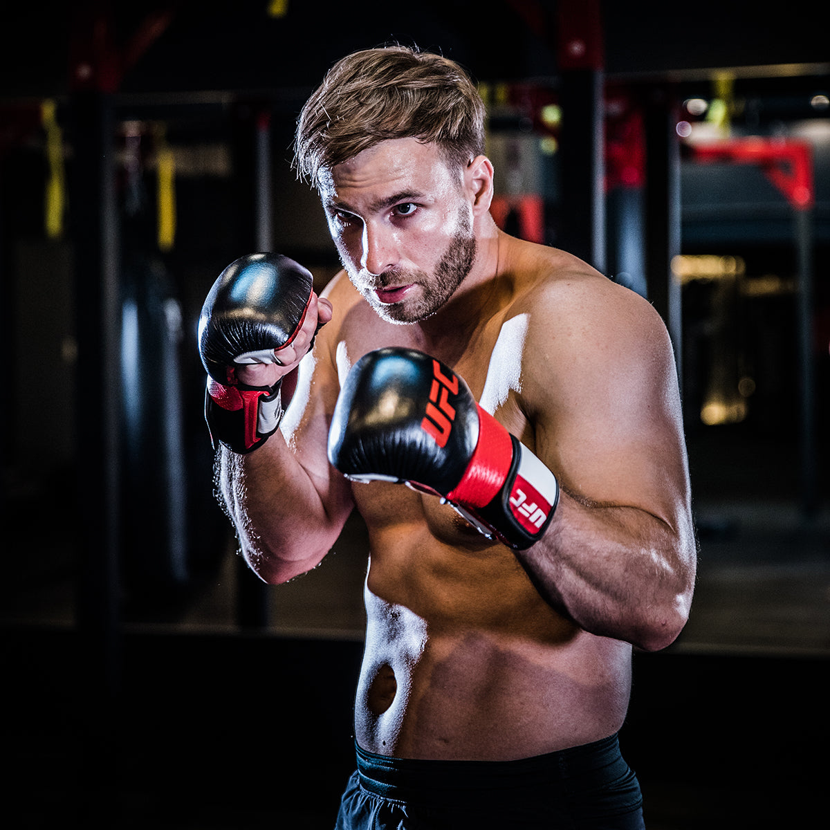 Athlete ready to spar while wearing the UFC Pro MMA Sparring Gloves