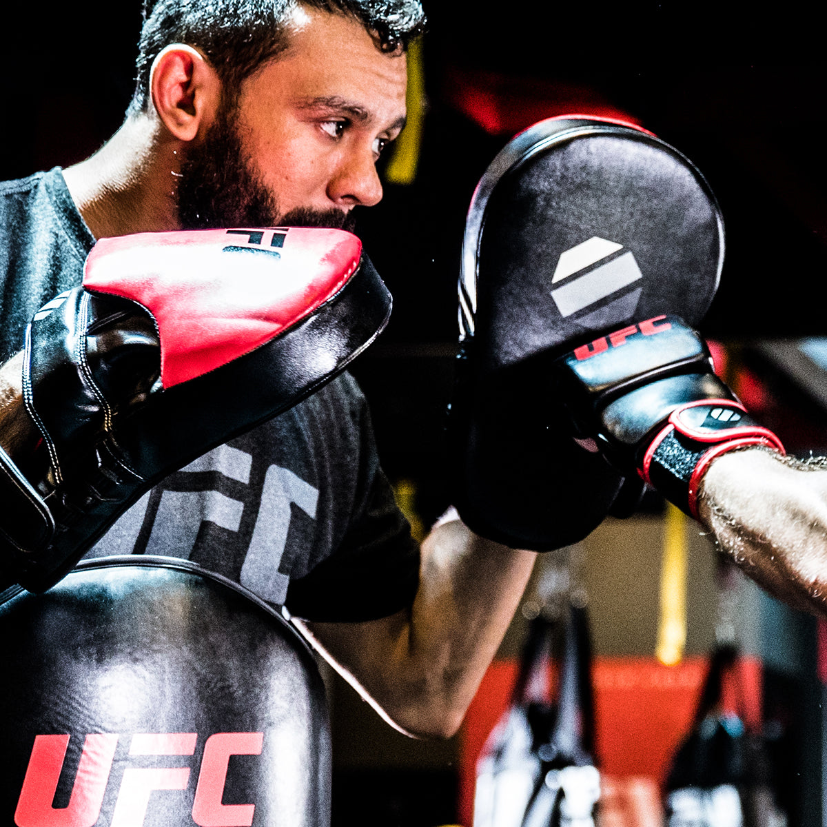 UFC Long Curved Focus Mitt being punched by athlete in training