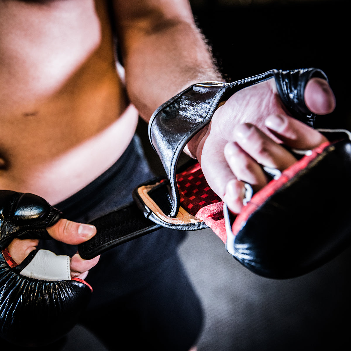 UFC Pro MMA Sparring Gloves being put on by athlete