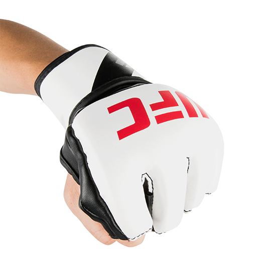 Pre-curved anatomically correct impact dispersing foam layered over knuckles for enhanced protection