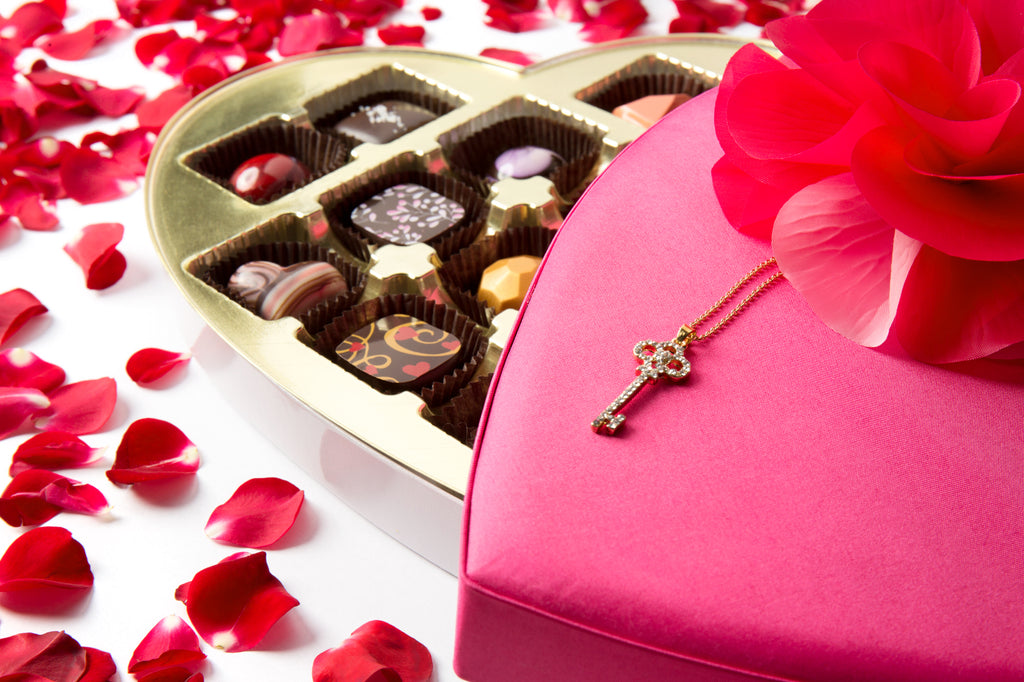 Pink heart shaped box of chocolates with rose petals from St. Croix Chocolate Company