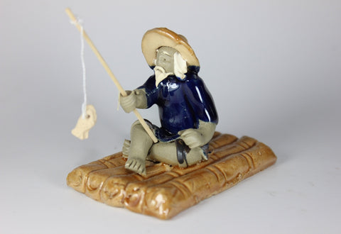 "Glazed Bonsai Fishing Mudman on Raft Figurine 2.25""x3"""