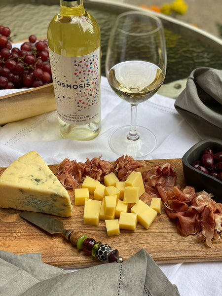charcuterie board with Osmosis wine