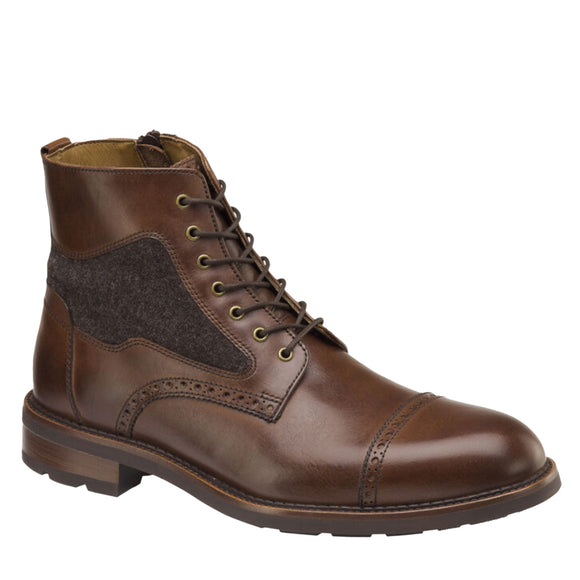 J&M EST. 1850 Collection.  Italian calfskin and wool handsomely defined by bolder brogueing and hand-finished details. Inside zip for on/off ease.   Leather lining.  Ortholite®/memory-foam cushioned footbed. Rubber sole.
