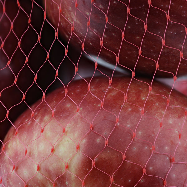 "Close-up of Apples in 24"" Red Plastic Mesh Bag"