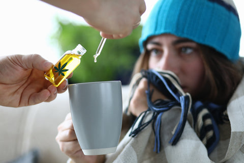 young-woman-with-anxiety-dripping-Delta-8-THC-into-cup