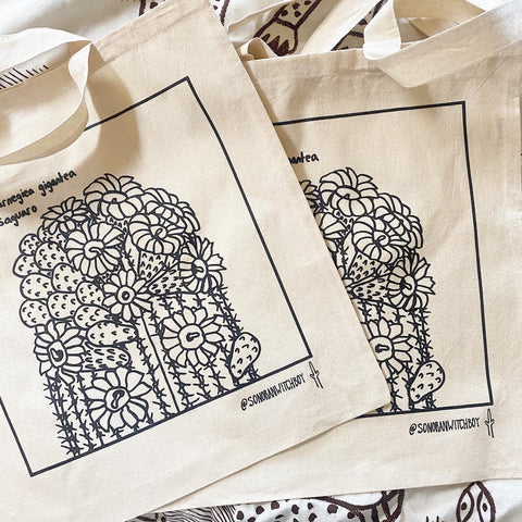 Screenprinted cotton tote bags with blooming saguaro cactus fruit and flowers