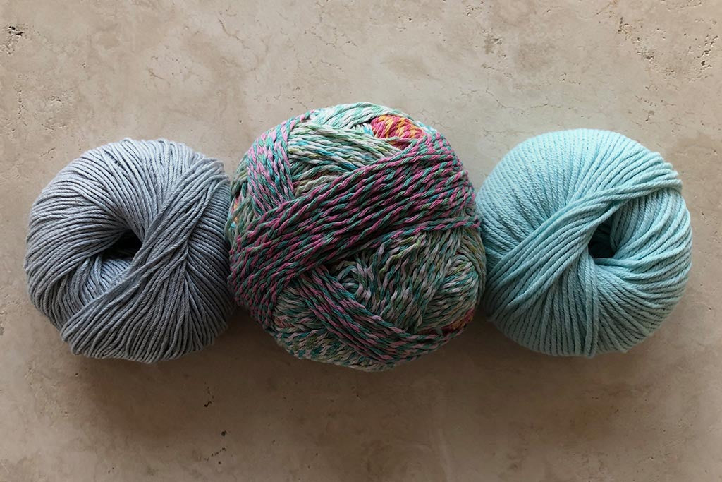 Yarn skeins on a stone background