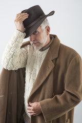 Hayes Ski Sweater w/ overcoat and hat on model – James Cox Knits