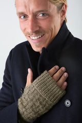 Keith Fingerless Gloves in Taupe on model wearing winter coat – James Cox Knits