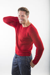 Kurt Cashmere Pullover sweater on model in Seeing Red – casual jeans/no shirt – James Cox Knits
