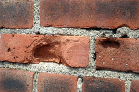 cracked brick surfaces with spalling damage
