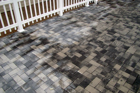 concrete sealer drying on pavers