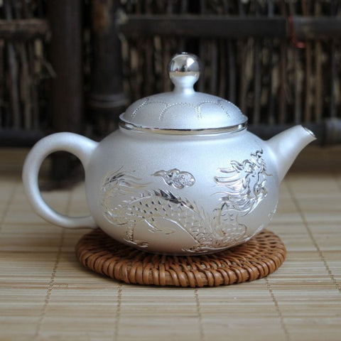 Silver Teapots and Wares