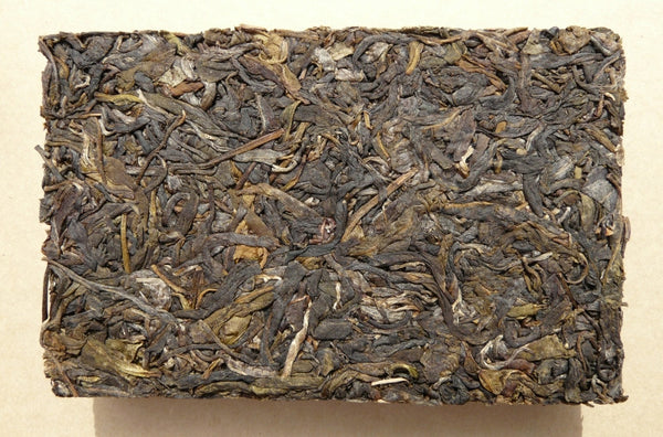 "2003 Tai Lian ""Yi Wu Mountain"" Raw Pu-erh Tea Brick"