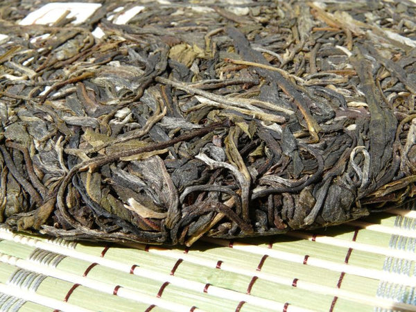 "2009 Yunnan Sourcing * Road to Yi Wu ""Ding Jia Zhai"" Raw Pu-erh Tea Cake"