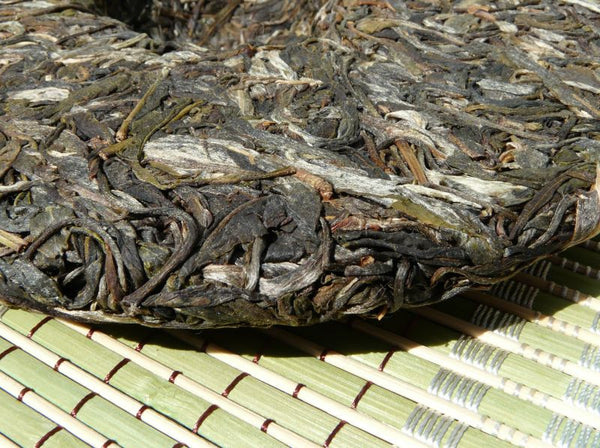 "2009 Yunnan Sourcing * Road to Yi Wu ""Man Zhuan"" Raw Pu-erh Tea Cake - Yunnan Sourcing Tea Shop"