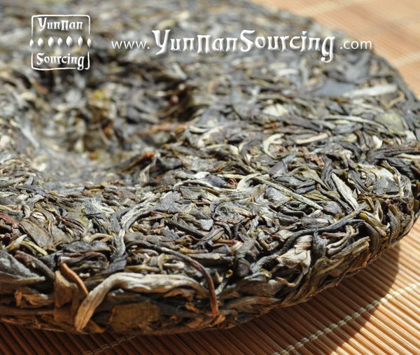 "2010 Yunnan Sourcing ""Big Snow Mountain"" Raw Pu-erh Tea Cake - Yunnan Sourcing Tea Shop"
