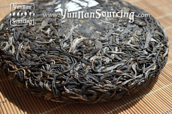 "2010 Yunnan Sourcing ""Ge Deng"" Raw Pu-erh Tea Cake - Yunnan Sourcing Tea Shop"