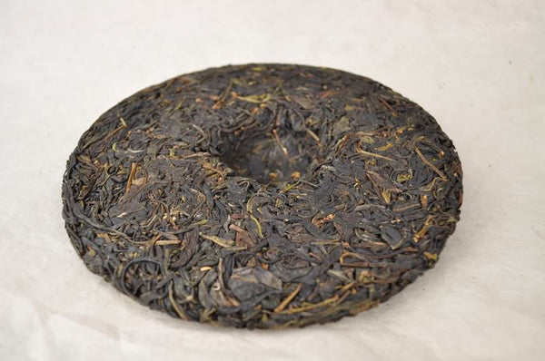 "2012 Yunnan Sourcing ""Yi Wu Purple Tea"" Raw Pu-erh Tea Cake"