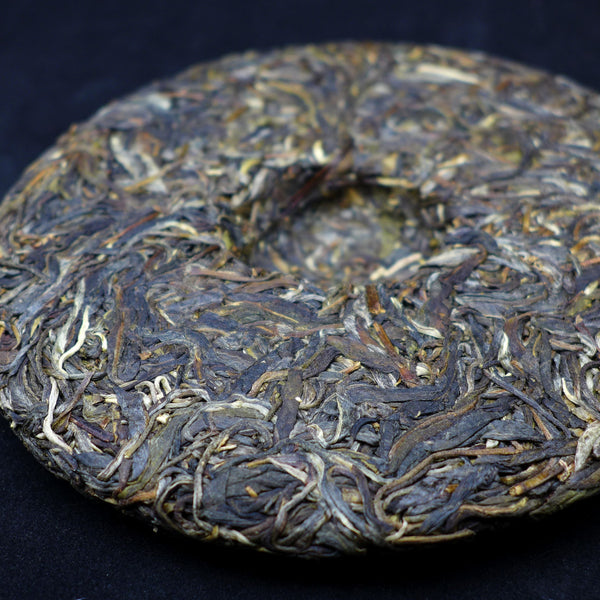 "2014 Yunnan Sourcing ""Autumn Man Zhuan"" Ancient Arbor Raw Pu-erh Tea Cake"