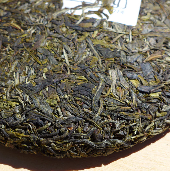 2014 Yunnan Sourcing Wu Liang Mountain Wild Arbor Raw Pu-erh Tea Cake