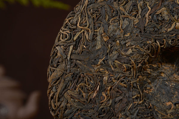 "2004 ""Millenial Old Tree"" Big Snow Mountain Mengku Raw Pu-erh Tea Cake"