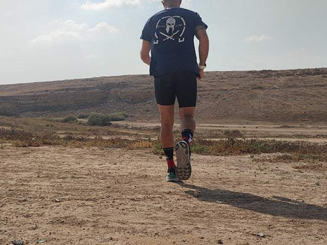 a man running in the heat in the desert
