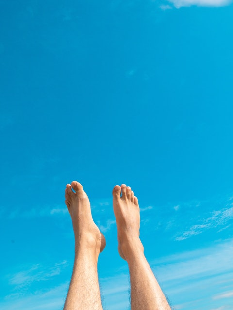 man's feet lifted in the air