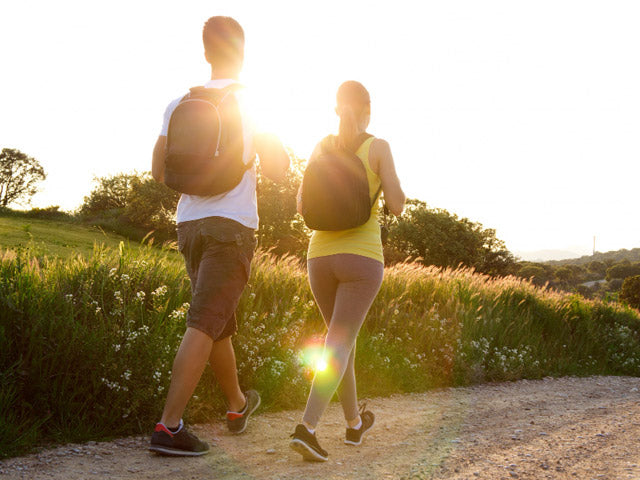 couple fast walking outdoors as a part of running plan for beginners