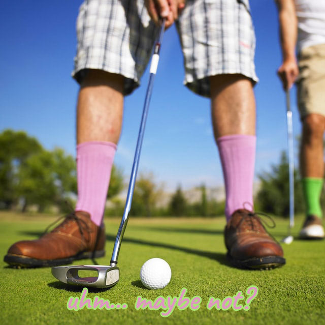 golfer in pink socks about to hit the ball