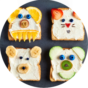 Healthy kids snack fruit sandwiches shaped like animals.