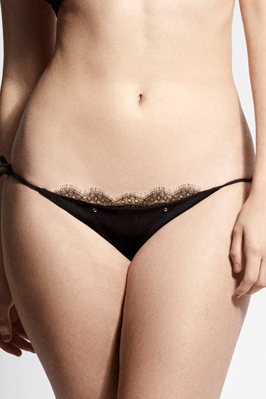 Black lace tie side bikini briefs. Nadine is the debut swimwear collection from luxury lingerie brand Edge o' Beyond.