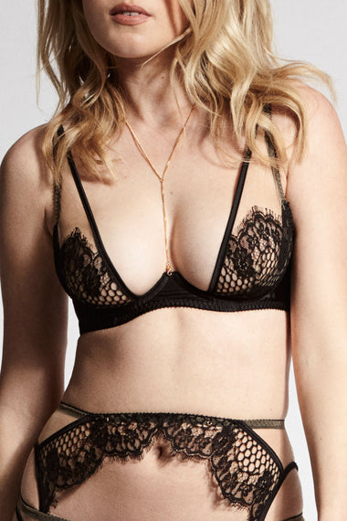 The dramatic peek-a-boo of the lace + black satin Kathryn bra provides full cleavage, light padding and is part of one of Edge o' Beyond's most risqué collections.
