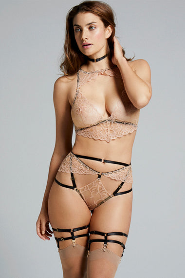 Bondage-inspired garters are an alternative to a suspender belt. Created to hold up stockings and complete any Edge o' Beyond underwear look. Finished with 24 carat gold hardware to match our gold jewellery. The perfect add on to lingerie shopping. Shown with Colette bra, thong and choker set on plus size lingerie model