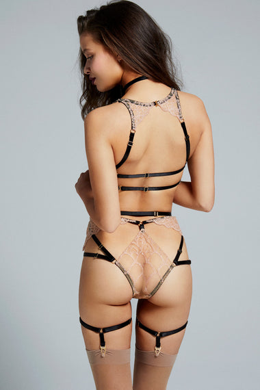 Back view of bondage-inspired garters are an alternative to a suspender belt. Created to hold up stockings and complete any Edge o' Beyond underwear look. Finished with 24 carat gold hardware to match our gold jewellery. The perfect add on to lingerie shopping. Shown with Colette bra, thong and choker set.