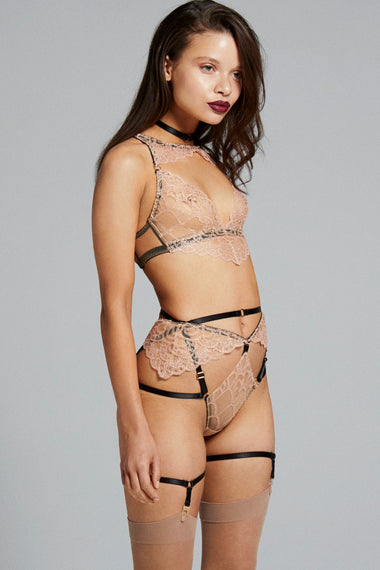 Side view of bondage-inspired garters are an alternative to a suspender belt. Created to hold up stockings and complete any Edge o' Beyond underwear look. Finished with 24 carat gold hardware to match our gold jewellery. The perfect add on to lingerie shopping. Shown with Colette bra, thong and choker set.