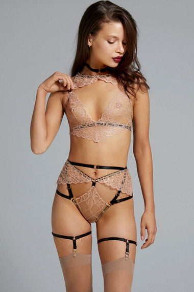 Bondage-inspired garters are an alternative to a suspender belt. Created to hold up stockings and complete any Edge o' Beyond underwear look. Finished with 24 carat gold hardware to match our gold jewellery. The perfect add on to lingerie shopping. Shown with Colette bra, thong and choker set.