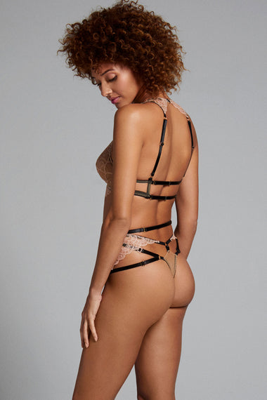 Alternate view Edge o' Beyond thong A new and unique shape crafted in the UK with gilt threaded French embroidery, delicate rose gold scallops, bondage-inspired strapping and finished with 24 carat gold plated hardware. Colette range is a lingerie lovers must have. Shown with Colette bra