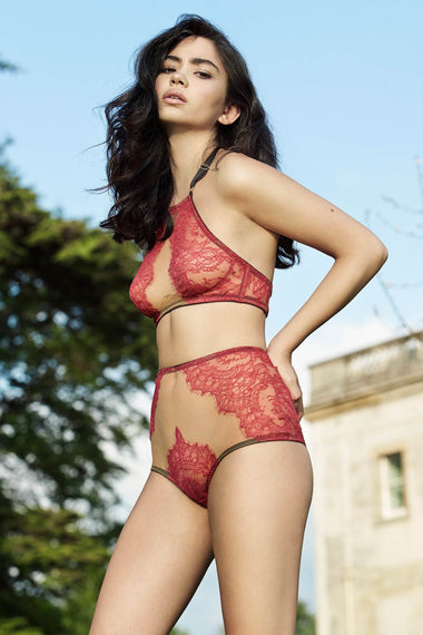 The Edge o' Beyond Elise peep bra crafted from red rouge French Chantilly lace + luxury 24 carat gold plated details. Cups add push up and support. Bondage inspired adjustable back and halter neck mean a good plus size lingerie or underwear option. Worn with high waist sheer brief