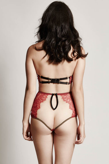 Back view of Edge o' Beyond Elise peep bra crafted from red rouge French Chantilly lace + luxury 24 carat gold plated details. Cups add push up and support. Bondage inspired adjustable back and halter neck mean a good plus size lingerie or underwear option. High waist brief sheer underwear option