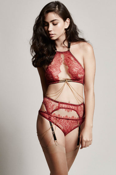 Edge o' Beyond Elise peep bra crafted from red rouge French Chantilly lace + luxury 24 carat gold plated details. Cups add push up and support. Bondage inspired adjustable back and halter neck mean a good plus size lingerie or underwear option. Suspender belt and brief with 18k gold plated jewellery full range