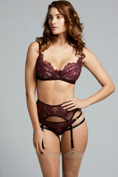 Fabienne features corded French Lace in rich mulberry. Finished with adjustable, bondage-inspired silky straps and gold dipped rings the underwired, lace covered, three piece push up bra is the ultimate lingerie piece. Full underwear set shown on plus size lingerie model