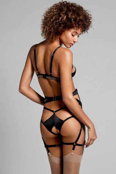 Edge o' Beyond Madeleine suspender is made from black silk and 18 carat gold dipped rings. This women's lingerie garter belt is almost corset like as it draws in the waist.  Back view shown with brief and bra