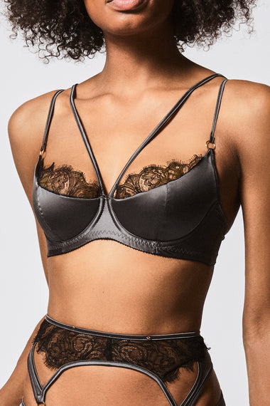 Close up view of The Edge o' Beyond Miline bra is structured in silky satin and black French Leavers lace. This lingerie is a push up bra with padding. Shown with suspender belt