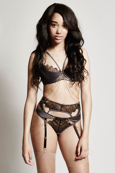 The Edge o' Beyond Miline suspender belt is structured in silky satin and black French Leavers lace. Suspenders finish any lingerie set perfectly. Shown as complete set with bra and thong