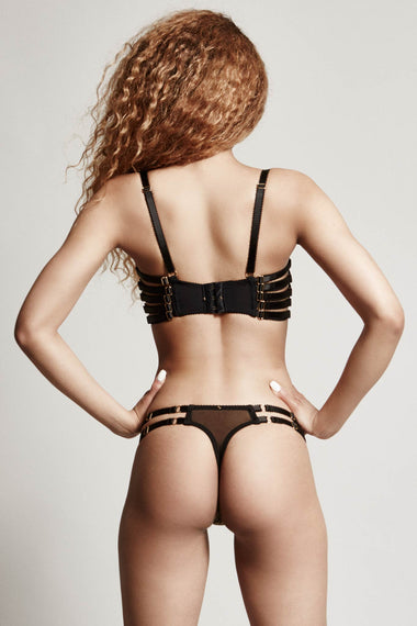 Edge o' Beyond Lingerie. The Valma thong is made with delicate gold thread, a rose floral design and bondage inspired strapping. Worn with matching underwear bra, shown as back view